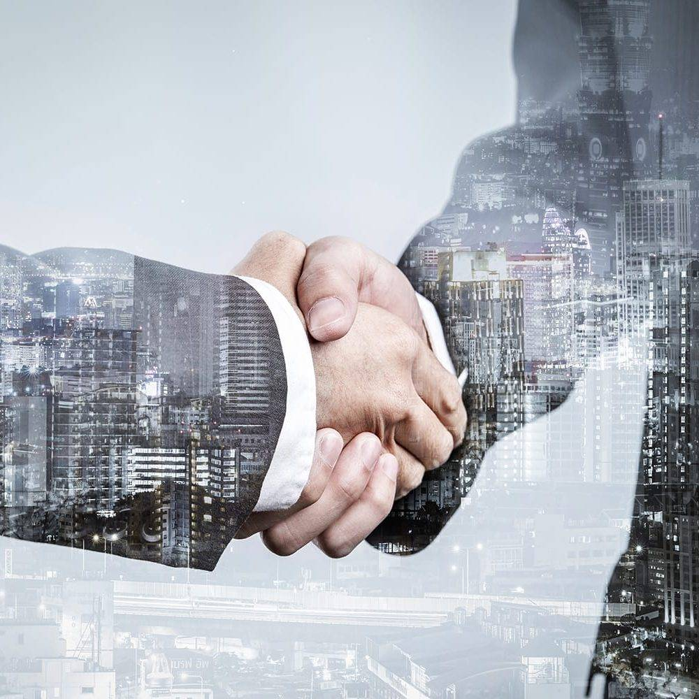Double exposure of business partnership handshake and modern city , Successful business greeting or agreement after perfect deal