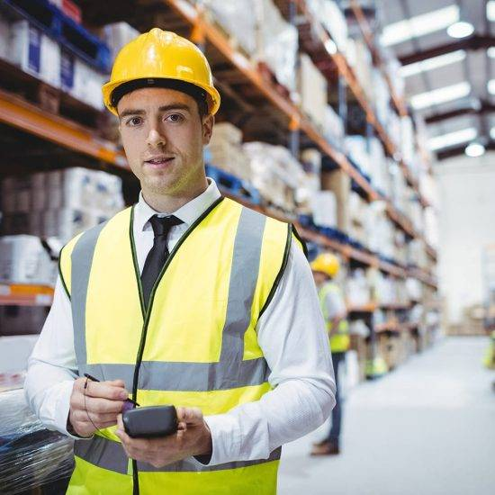 Portrait of smiling warehouse manager looking at the camera