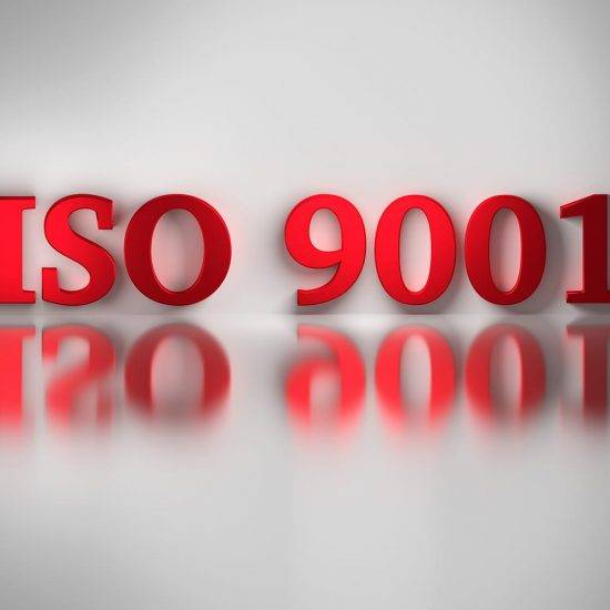 Red letters of ISO 9001 quality standard for a quality management system reflected on the white surface. ISO 9001 on white background. 3D illustration.
