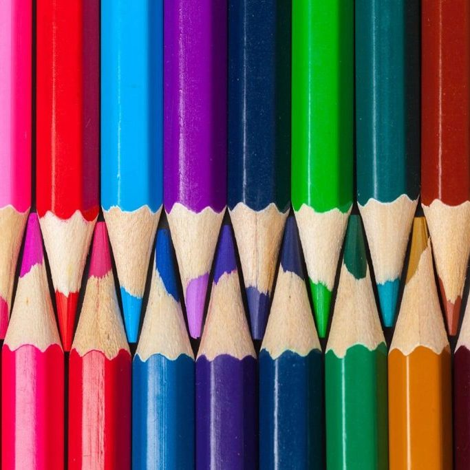 Set of colored pastel pencils in row multi color in form of closed zipper