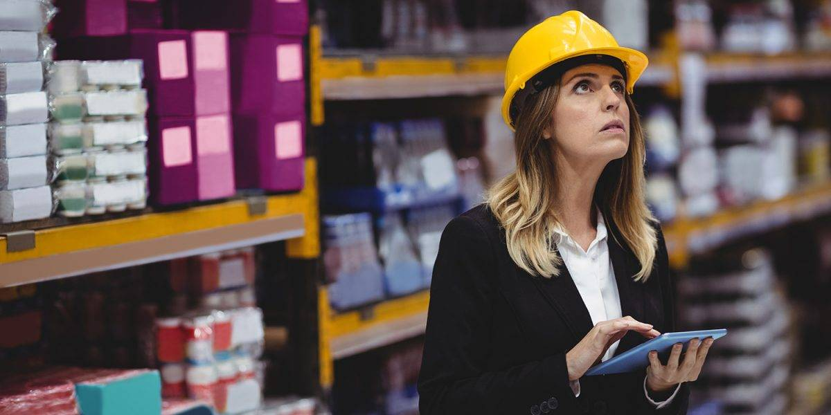 Businesswoman using tablet in warehouse
