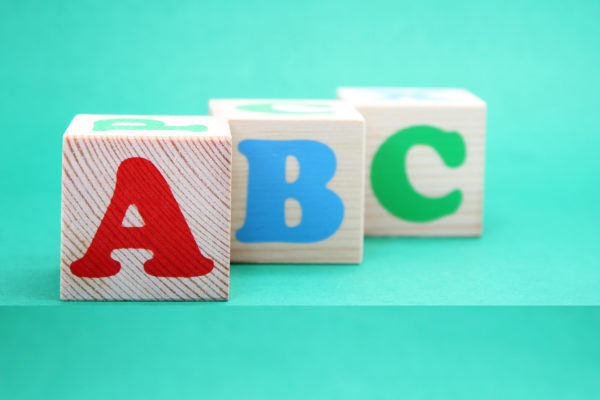 English ABC letters on wooden toy blocks. letters of the English alphabet. Learn foreign languages. English for beginners. Copy space.